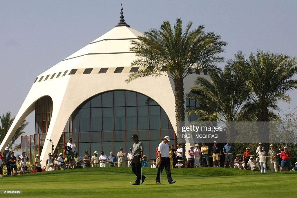 World number one golfer Tiger Woods (L) of the US and Thomas Bjorn of Denmark walk the golf course during the Dubai Desert Classic 03 March 2001. Bjorn is one stroke behind Woods in the 1.5 million dollar tournament. AFP PHOTO/Rabih MOGHRABI
