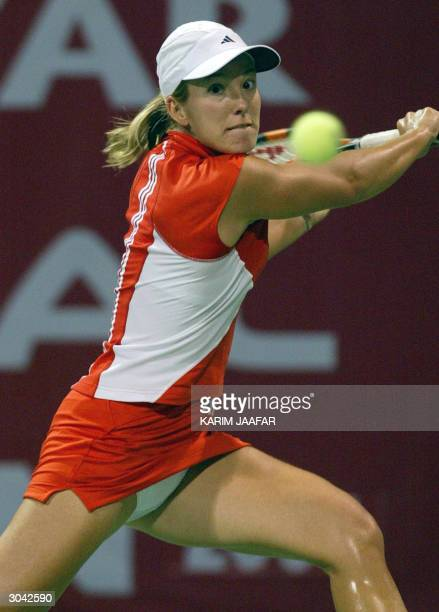 World Number One Justine HeninHardenne of Belgium hits a return to her French opponent Nathalie Dechy during their quarter final match in the WTA...