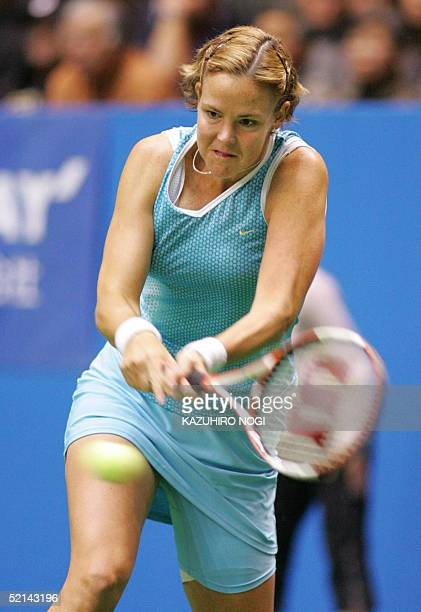 World number one Lindsay Davenport of the US returns a ball during the final match against Wimbledon champion Maria Sharapova of Russia at the Pan...