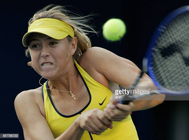 World number one Maria Sharapova of Russia plays a backhand shot during her second round match against Shahar Peer of Israel at the 11 million USD...