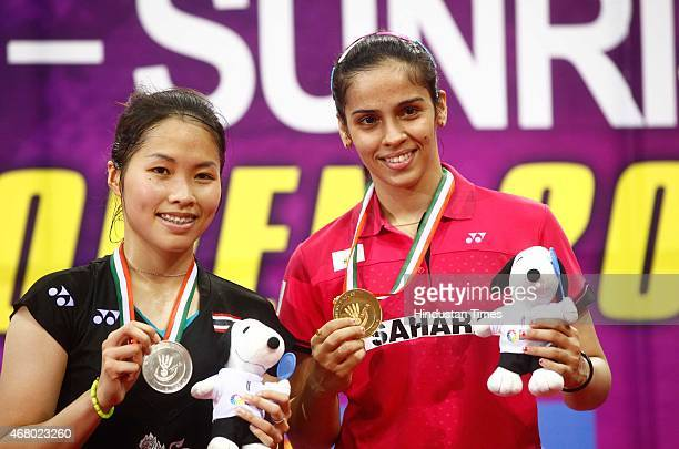 World number one player Saina Nehwal and Ratchanok Intanon badminton player from Thailand at an award ceremony during the Yonex Sunrise India Open...