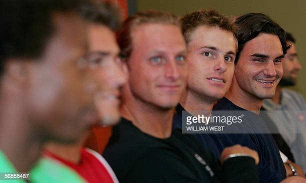 World number one Roger Federer of Switzerland smiles as he listens to a question with Andy Roddick of the US David Nalbandian of Argentina Germany's...