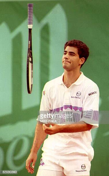 World number one seed Pete Sampras of the US tosses his racquet while playing Amos Mansdorf in the semifinals of the Hong Kong Open 17 April 1993...