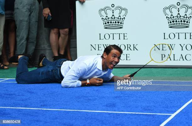 World number one tennis player Rafael Nadal of Spain falls down during his match against Venus Williams of the USA as they participate in the Lotte...