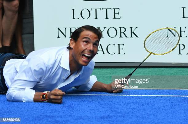 TOPSHOT World number one tennis player Rafael Nadal of Spain falls down during his match against Venus Williams of the USA as they participate in the...