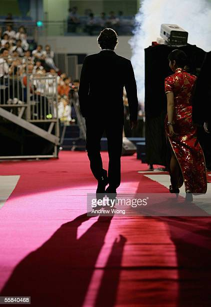 World Number One tennis player Roger Federer arrives to open Qizhong Tennis Center, where the 2005-2007 ATP Tennis Masters Cup will be held, on...