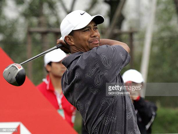 World number one Tiger Woods tees off during a practice round at the fivemilliondollar HSBC Champions tournament in Shanghai 09 November 2005 The...