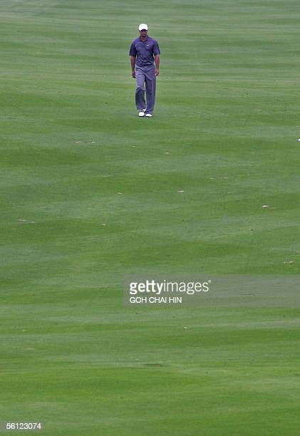 World number one Tiger Woods walks down the fairway all by himself during a practice round at the fivemilliondollar HSBC Champions tournament in...