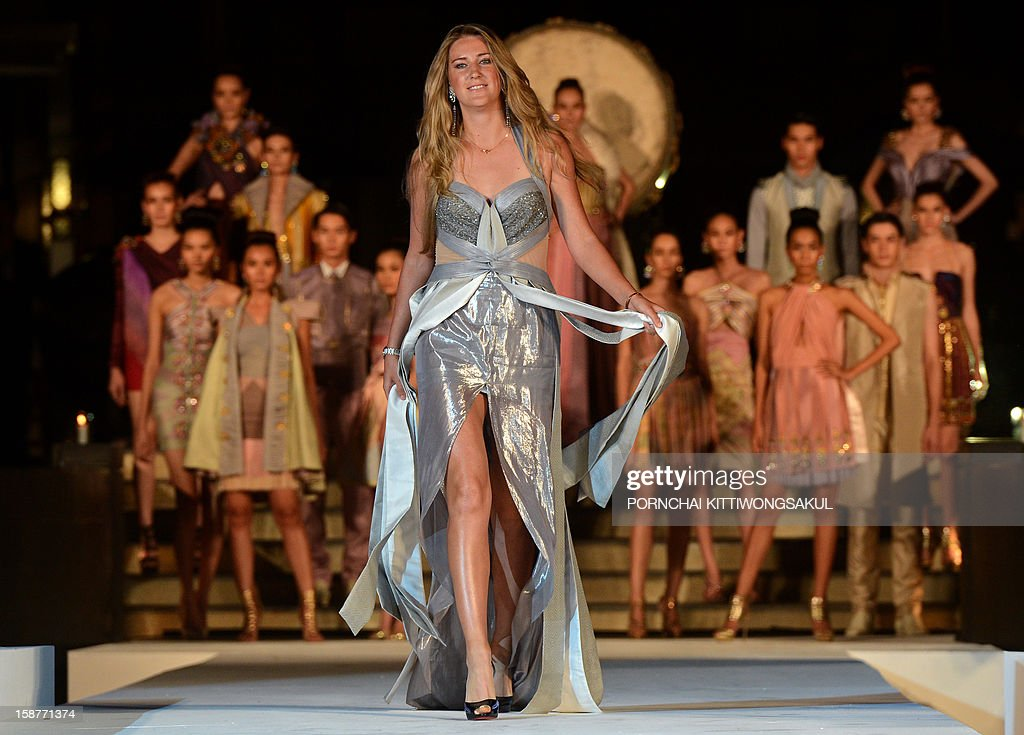 World number one woman's tennis player Victoria Azarenka of Belarus walks the cat walk during the Thai silk fashion show in Thailand's resort seaside town of Hua Hin on December 28, 2012