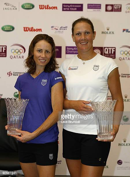 World number one womens doubles team Liezel Huber of the USA and Cara Black of Zimbabwe hold their trophies and pose for a photograph during the Sony...