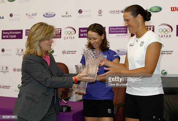 World number one womens doubles team Liezel Huber of the USA and Cara Black of Zimbabwe receive their trophies from Stacey Allaster, Chairman and CEO...