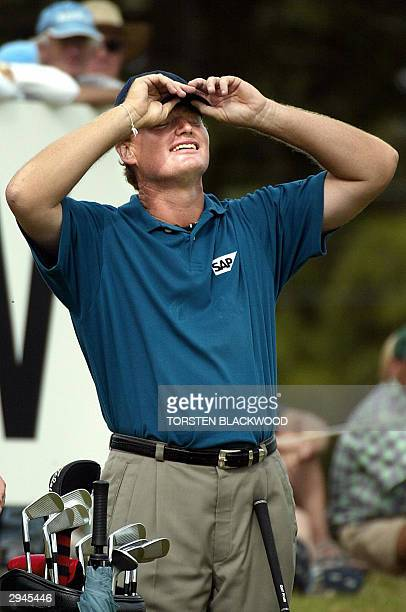 World number three Ernie Els of South Africa reacts to losing his outright lead on the 9th hole during the final round of the Heineken Classic at the...
