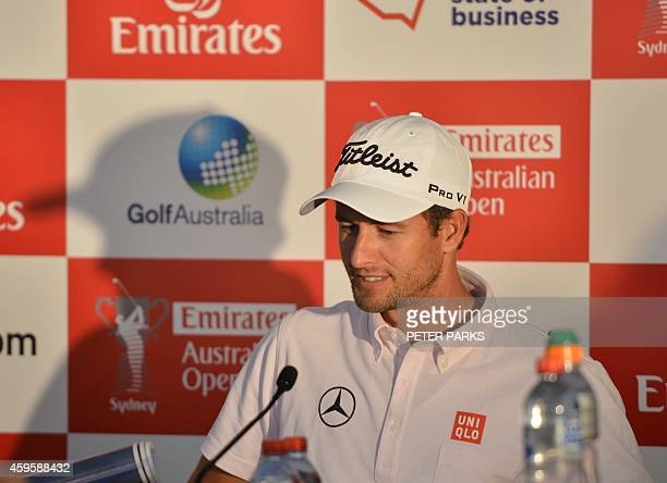 World Number three golfer Adam Scott attends a press conference before the start of the Australian Open golf tournament at the Australian Golf Club...