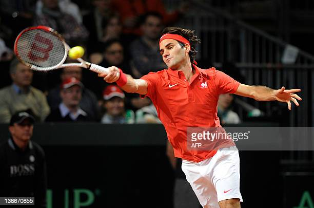 World number three tennis player Roger Federer of Switzerland returns plays a return to John Isner of the US during a Davis Cup World Group first...