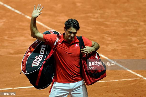 World number three tennis player Roger Federer of Switzerland waves to supporters after losing his match against John Isner of the US during a Davis...