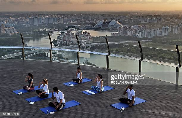 World number three tennis player Simona Halep of Romania takes part in a yoga session at skypark observation deck at the top of the Marina Bay Sands...