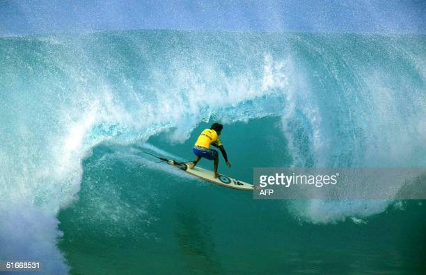 World number two Californian Rob Machado competes on the North Shore Oahu Hawaii 14 December 2002 The Xbox Pipeline Masters is the final jewel in the...