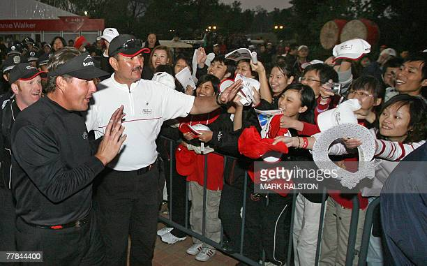 World number two Phil Mickelson of the US waves to Chinese fans after winning the five million USD HSBC Champions golf tournament at the Sheshan...