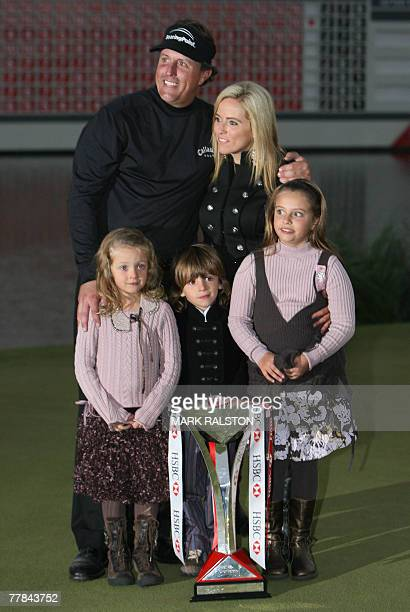 World number two Phil Mickelson of the USA poses with his wife Amy and children Sophia Isabel Evan and Amanda Brynn with the trophy after winning the...
