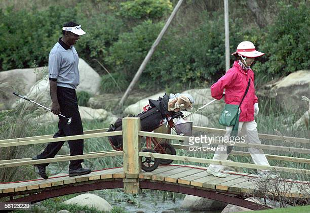 World number two Vijay Singh follows a caddy across a bridge during a practice round at the fivemillion USD HSBC Champions tournament in Shanghai 09...