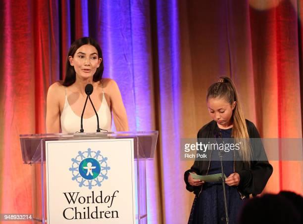 World of Children Ambassador Lily Aldridge Followill and Rain Charvet speak on stage at the 2018 World of Children Hero Awards Benefit at Montage...