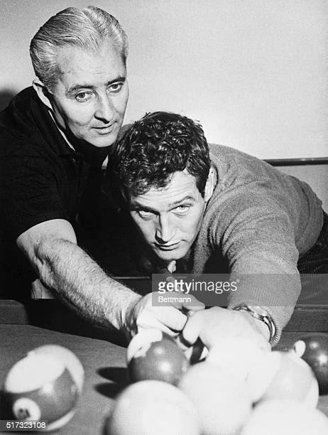World pocket billiards champion Willie Mosconi teaches Paul Newman a few trick shots for Newman's starring role in The Hustler
