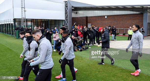 World press shooting the players as they walk out before a training session at Melwood training ground on March 10 2020 in Liverpool United Kingdom...