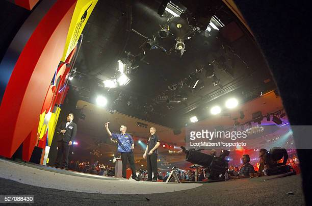 World Professional Darts Championships Lakeside Country Club Frimley Green UK Ist round action David Cameron CAN v Martin Adams ENG Wesley Harms NTH...
