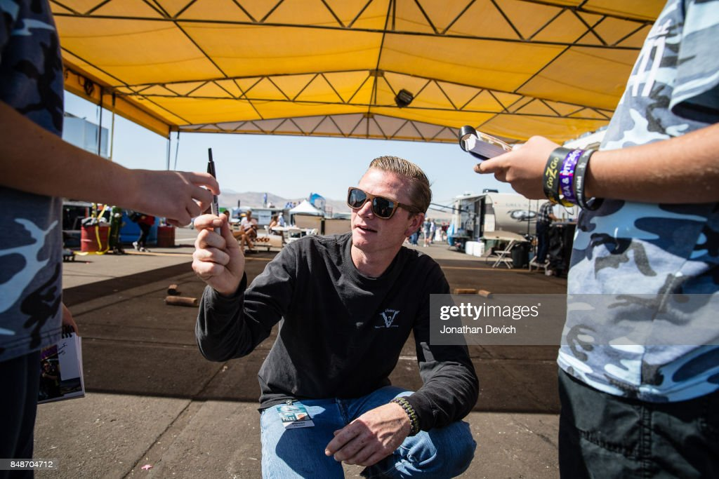 World record holder Steve Hinton signs autographs for fans at the Reno Championship Air Races on September 17, 2017 in Reno, Nevada.