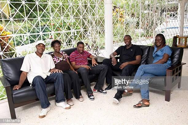 World record sprint holder Usain Bolt is photographed at home with his family from left to right Wellesley Bolt Christine BoltHylton Sadiki Runako...