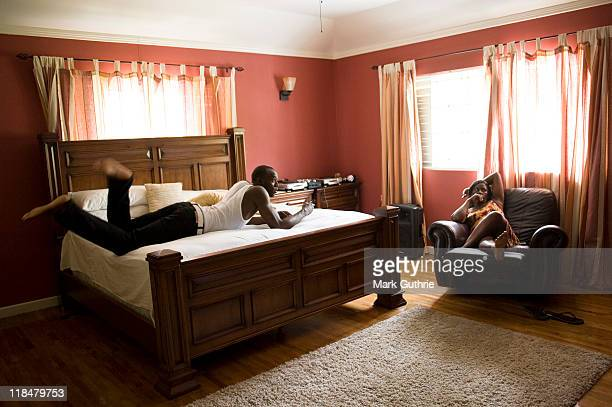 World record sprint holder Usain Bolt is photographed relaxing at home with his mother Jennifer Bolt on February 23 2010 in Kingston Jamaica