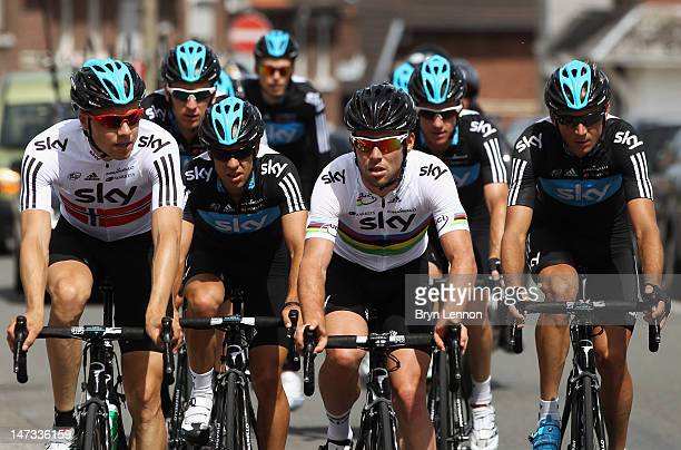 World Road Race Champion Mark Cavendish of Great Britain and SKY Procycling rides with team mate Edvald Boasson Hagen of Norway during a training...
