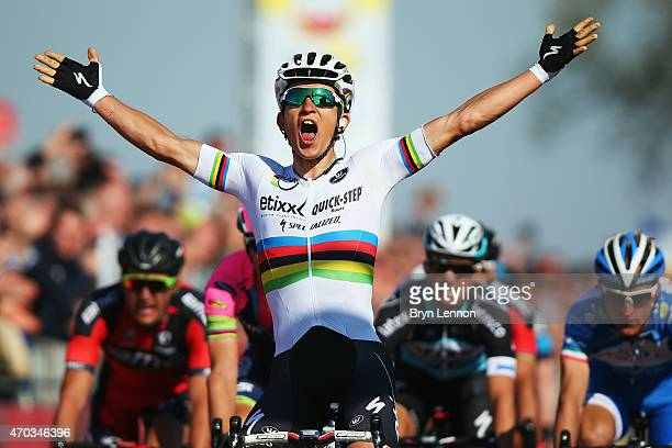 World Road Race Champion Michal Kwiatkowski of Poland and the Etixx-QuickStep team celebrates winning the 50th Amstel Gold Race on April 19, 2015 in...