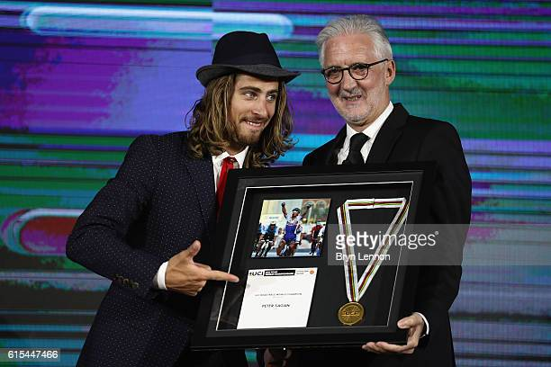 World Road Race Champion Peter Sagan of Slovakia accepts his award from UCI President Brian Cookson on stage at the 2nd UCI Gala Awards 2016 on...