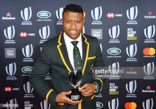 World Rugby Breakthrough Player of the Year award Aphiwe Dyantyi from South Africa poses with his trophy during the World Rugby Awards on November 25...