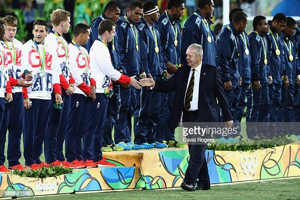 World Rugby Chairman Bill Beaumont shakes hands with Great Britain players during the medal ceremony for the Men's Rugby Sevens on Day 6 of the Rio...