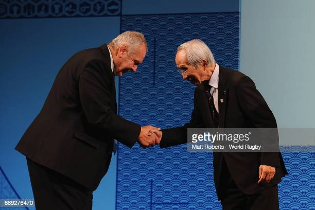 World Rugby via Getty Images President Bill Beaumont and Japan Rugby Football Union President Tadashi Okamura shake hands during the Rugby World Cup...