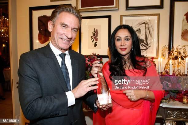 VP world sales at Danone Waters Laurent Cintrat and HRH Princess Diya Kumari of Jaipur pose with the 'Evian Water Bottle Princess Diya Kumari of...