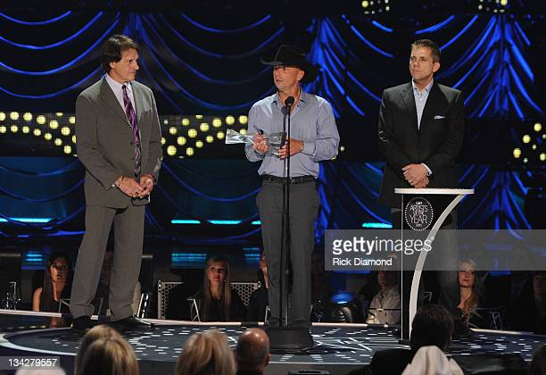 World Series Champion Coach Tony Larussa Kenny Chesney and NO Saints Coach Sean Payton at the 2011 CMT Artists of the year celebration at the...