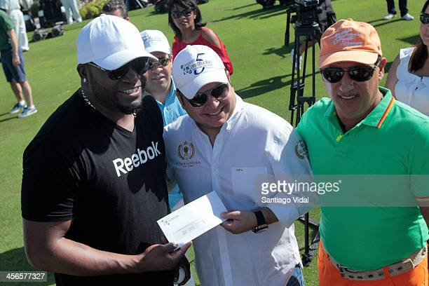 World Series Champion & MVP David Ortiz receives a donor check for his foundation during the David Ortiz 6th Celebrity Golf Classic at Punta Espada...