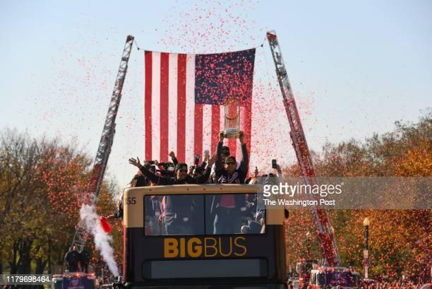 World Series Champions Washington Nationals manager Dave Martinez and Washington Nationals first baseman Ryan Zimmerman celebrate on a bus in a...