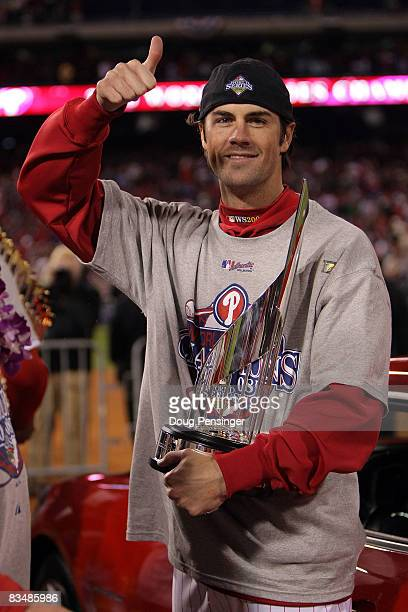 World Series MVP Cole Hamels of the Philadelphia Phillies celebrates with the MVP trophy after their 4-3 win to win the World Series against the...