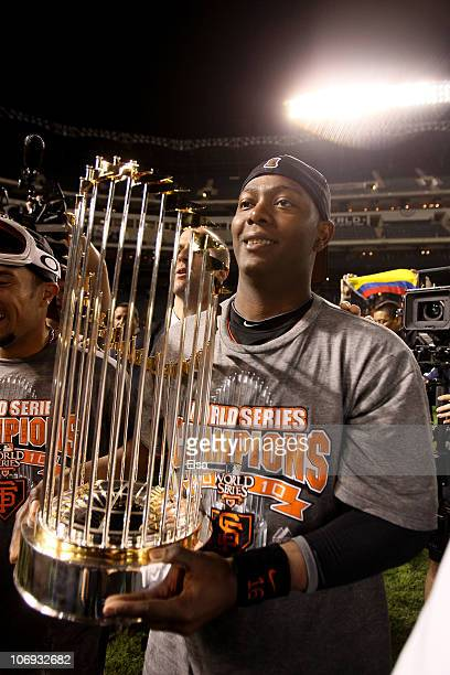 World Series MVP Edgar Renteria of the San Francisco Giants celebrates on the field with the World Series Championship trophy after the Giants won 31...