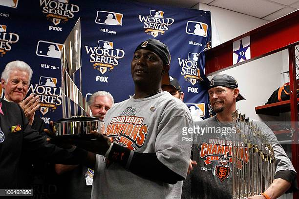 World Series MVP Edgar Renteria of the San Francisco Giants receives his MVP trophy in the locker room after the Giants won 31 against the Texas...