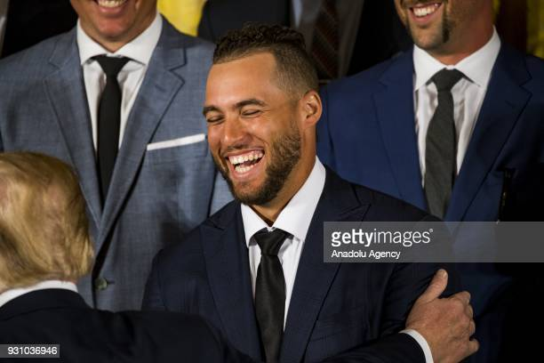 World Series MVP George Springer is congratulated by President Donald Trump during a ceremony honoring the Major League Baseball 2017 World Series...