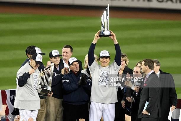 World Series MVP Hideki Matsui of the New York Yankees holds up the MVP trophy as he celebrates their 7-3 win against the Philadelphia Phillies in...