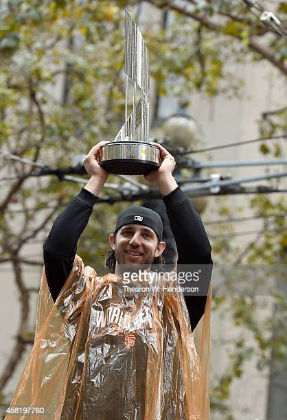 World Series MVP Madison Bumgarner of the San Francisco Giants shows his MVP trophy to the crowd along the parade route during the San Francisco...
