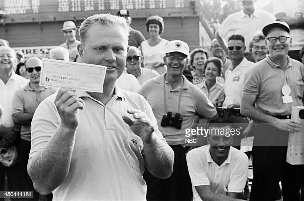 Professional golfer Jack Nicklaus recieves his winning check