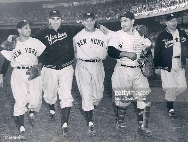 World Series with the New York Yankees vs the New York Giants Phil Rizutto Vic Raschi Allie Reynolds and Yogi Berra celebrate a Yankee win