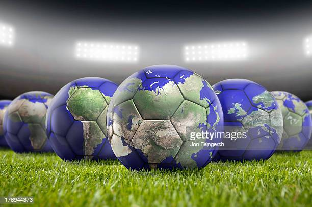 world soccer balls on pitch - fifa world cup stock pictures, royalty-free photos & images